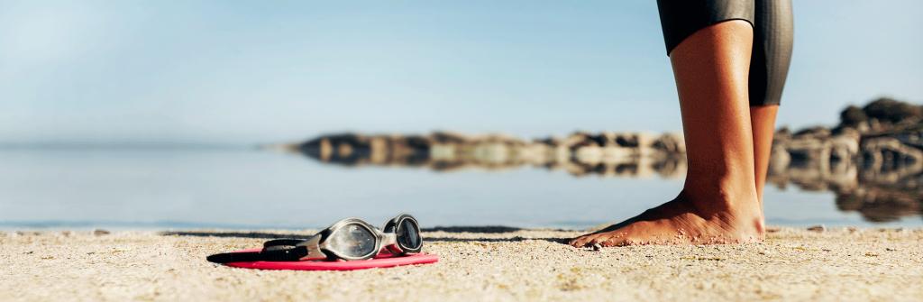 NSF open water briller og hette i sand